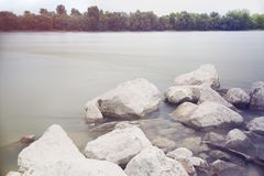Long Exposure Danube Landscape. With Tree Line and White Rocks stock photography