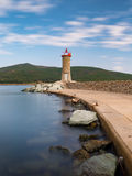 Long exposure day photo of Lighthouse in Macinaggio marina Corsi Royalty Free Stock Photos