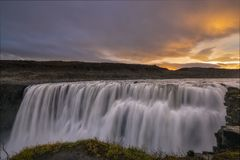 Frontal view of Dettifoss waterfall. Long exposure of Dettifoss waterfall in Northern Iceland at sunrise royalty free stock photo