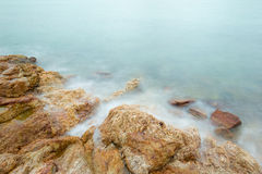 Long exposure of dreamy seascape and rocks. In Thailand Stock Images
