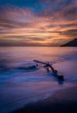 Long exposure of driftwood amazing sunset colors. Long exposure of driftwood amazing sunset colors in Corfu Greece Ionoan Islands Europe Royalty Free Stock Image