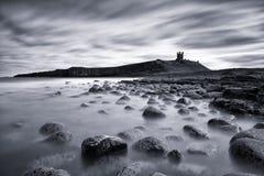 Long Exposure of Dunstanburgh Castle. Long exposure shot of Dunstanburgh Castle, on the Northumberland coast Stock Image