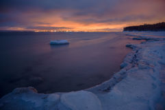 Long exposure of dusk over frozen shoreline Royalty Free Stock Image