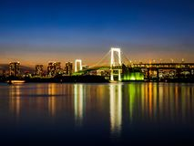 Long exposure of the famous landmark the Rainbow Bridge in Tokyo royalty free stock image