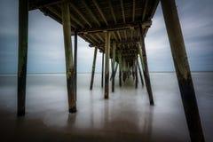 Long exposure of the fishing pier and Atlantic Ocean, in Virgini. A Beach, Virginia Royalty Free Stock Photo
