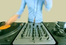 Long exposure of funky female dj. A long exposure shot of a funky female dj, mixing on turntables stock photos