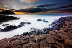 Long exposure of the Giants Causeway at sunset. Bushmills, Northern Ireland, 4th October 2014. Unesco World Heritage site The Giants Causeway at sunset Royalty Free Stock Photos