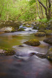 Long exposure gives silky glow on water of the river, Ireland. Walking the wicklow way through the glencree valley is beautiful stock photography
