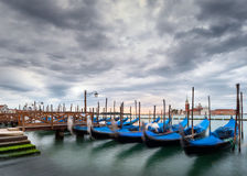 Long exposure of gondolas in the Grand Canal, Venice, Italy. Long exposure view of gondolas and San Giorgio church across the Grand Canal, Venice, Italy stock photo