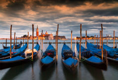 Long exposure of gondolas in the Grand Canal, Venice, Italy. Long exposure view of gondolas and San Giorgio church across the Grand Canal, Venice, Italy stock photos