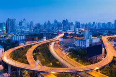 Long exposure, highway road curved with city downtown Stock Photos