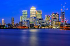 Long exposure, illuminated cityscape in Canary Wharf, London. Long exposure, illuminated cityscape in Canary Wharf, a major business district in east London Royalty Free Stock Photos