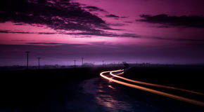 Long exposure image of a cars passing on a mountain road. In Slovakia Royalty Free Stock Photo