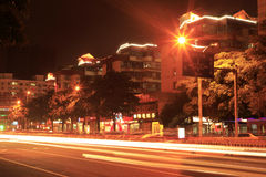 Long exposure image of cars rushing over a street Royalty Free Stock Photo