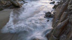 Long exposure image of crashing wave seascape with rocks.  royalty free stock photo