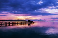 Long exposure image of Dramatic color sky seascape with reflection in sunset or sunrise scenery nature for background. Long exposure image of Dramatic color sky royalty free stock photography