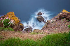 Long exposure image of rocks in wawes Stock Image