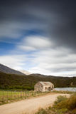 Old house. Long exposure image of streaky clouds and old house Royalty Free Stock Image