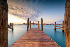 Long exposure of a jetty on the Grand Canal, Venice, Italy. Long exposure view of the San Giorgio church across jettys of the Grand Canal, Venice, Italy royalty free stock image