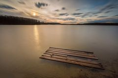 Long exposure lake with europoolpalette Stock Photos