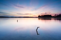 Long exposure lake at sunset Stock Photo