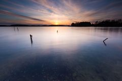 Long exposure lake at sunset Royalty Free Stock Photos