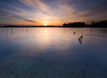 Long exposure lake at sunset Stock Photography