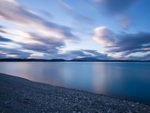 Long exposure of Lake Tekapo, New Zealand in the early morning hours stock photography