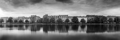 Long exposure with lakeside houses in city Royalty Free Stock Image