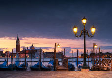 Long exposure of lamp-lit gondolas in the Grand Canal, Venice, I. Long exposure view of gondolas by lamp light with San Giorgio church across the Grand Canal stock images