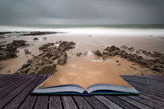 Long exposure landscape beach scene with moody sky Creative conc Royalty Free Stock Photo