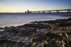 Long exposure landscape image of pier at sunset in Summer Royalty Free Stock Photo