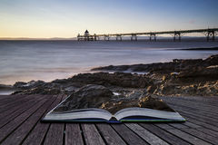 Long exposure landscape image of pier at sunset in Summer concep Stock Photography