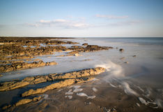 Long exposure landscape rocky shoreline at sunset Royalty Free Stock Photography
