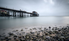 Long exposure landscape of Victorian pier  witn moody sky Stock Photo