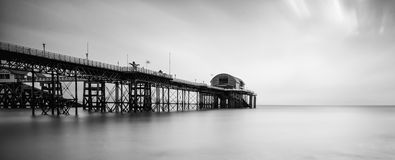 Long exposure landscape of Victorian pier  witn moody sky Stock Images