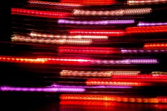 Long exposure light background. Glowing lights in motion. Selective focus stock image