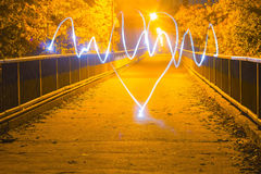 Long exposure, light painting heart. Long exposure at light painting photography heart stock image