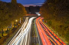 Long exposure light trails of traffic on a freeway royalty free stock photography