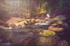Long exposure at a little river. With rocks Stock Photo