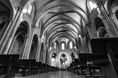 Long exposure low angle black and white church. VALENCIA, SPAIN - FEBRUARY 18, 2013: The interior of a magnificent church is beautifully lid by few lamps and Stock Images