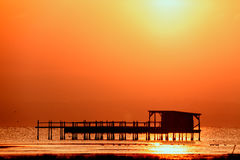 Long exposure of magic sunrise over the ocean with a hut in the. Middle Royalty Free Stock Images
