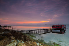 Long exposure of magic sunrise over the ocean with a hut in the Royalty Free Stock Image