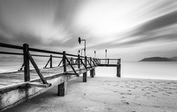 Long exposure of magic sunrise and wooden pier Royalty Free Stock Images