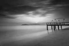 Long exposure of magic sunrise and wooden pier Stock Photo