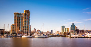 Long exposure of a marina and buildings on the waterfront in Baltimore, Maryland. Long exposure of a marina and buildings on the waterfront in Baltimore royalty free stock images