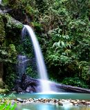 Long exposure of Montathan waterfall in the jungle of Chiang Mai Thailand royalty free stock photo
