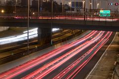 Light trails on an interstate. Long exposure of a motorway traffic at night - light trails painted in the shot Royalty Free Stock Image