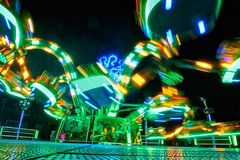 Long exposure of a moving fair attraction. With colorful light trails Stock Photography
