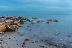 Night photography of rocks on the coast royalty free stock image